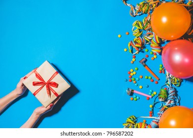 Happy birthday and holidays concept. Gift boxes and holidays accessories on blue background. Top view with copy space.