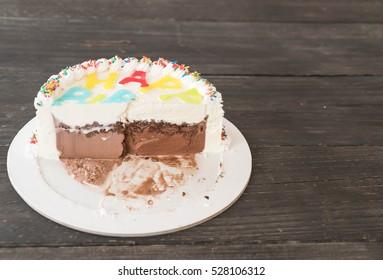 happy birthday ice-cream cake on table