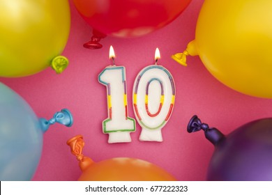 Happy Birthday number 10 celebration candle with colorful balloons