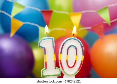 Happy Birthday number 10 celebration candle with colorful balloons and bunting