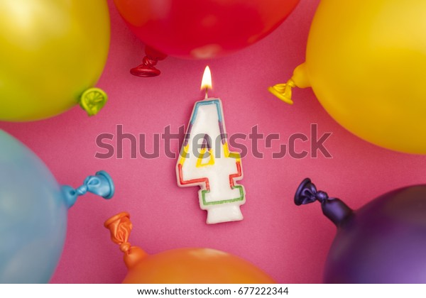 Happy Birthday number 4 celebration candle with colorful balloons