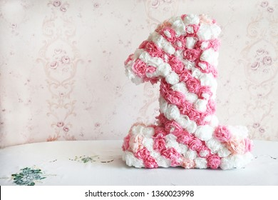 Happy birthday number1. Big sweet pink figure at home or restaurant interior. Decorative figure ONE with copy space. Cute handmade decoration for birthday party.