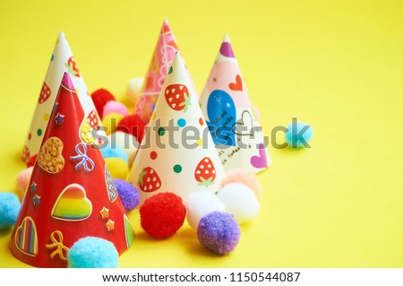 Happy Birthday Party Hats On Yellow Background With Copy Space