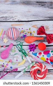 Happy Birthday party items flat lay. Multicolored party accessories on rustic wooden background. Happy birthday concept.