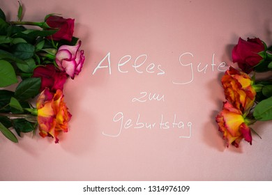 Happy birthday, with roses on pink background (alles Gute zum Geurtstag = Happy birthday)