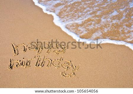 Happy Birthday Sign On A Beach