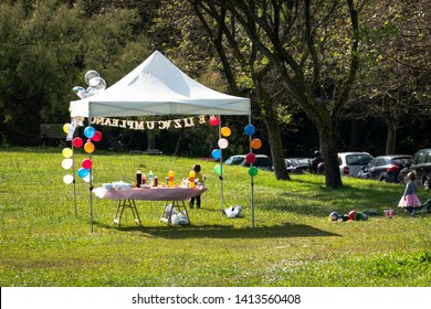 happy birthday tent in the yard or celebration tent or celebration day or happy birthday tent full of balloons , drinks and snacks or  celebration or happy birthday canopy tent