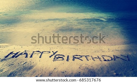 Happy Birthday Written On Beach Sand Blue See