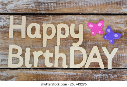 Happy Birthday Written With Wooden Letters On Rustic Wood