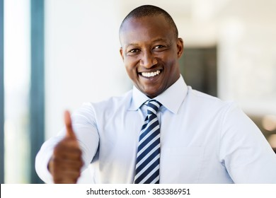 happy black business man giving thumb up in modern office