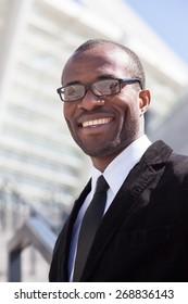 happy black businessman portrait