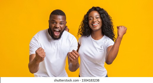 Happy Black Couple Rejoice Success Together, clenching fists and exclaiming, panorama