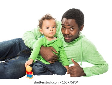 Happy black father and  baby boy cuddling on isolated white Use it for a child, parenting or love concept