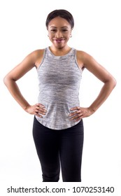 Happy Black female wearing athletic outfit on a white background as a fitness trainer