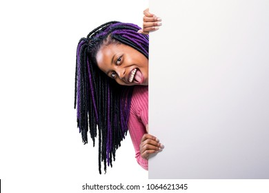 Happy black girl pointing at a banner