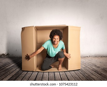 happy black woman inside a Box on a room