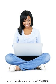 Happy black woman sitting with computer isolated on white background