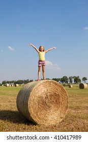 happy Blond girl on the hay in autumn field
