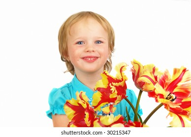Happy blond little girl with spring flowers  on isolated background