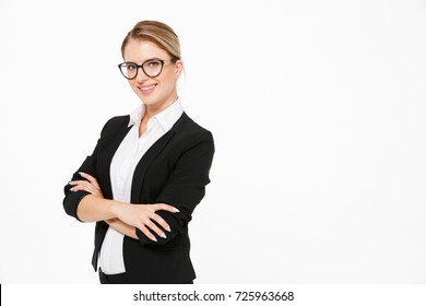 Happy blonde business woman in eyeglasses looking at the camera over white background
