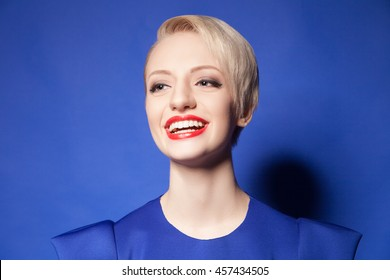 Happy blonde girl with short hair and red lips