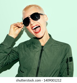 Happy Blonde Model in military style and fashion sunglasses