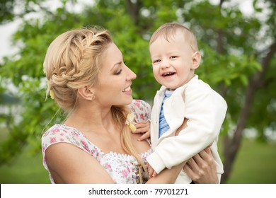 Happy blonde mom and son outdoors