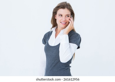 Happy blonde on the phone on white background