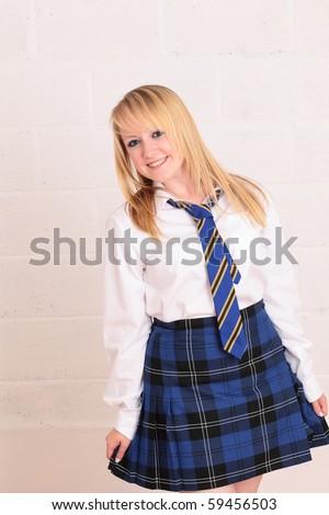Happy Blonde Schoolgirl In Uniform