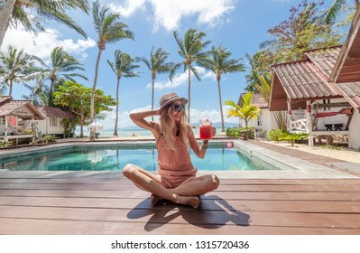 Happy blonde sexy woman on tropical background. Vacation, summer. Healthy lifestyle. Holiday concept. Swimming pool. Summer beach concept. Enjoy summer.