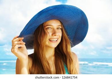 Happy blonde woman against sea water