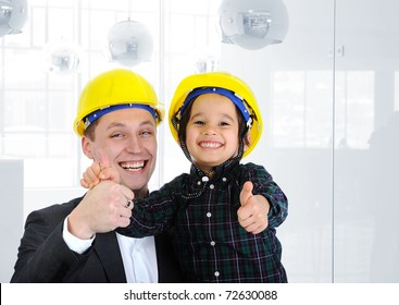 Happy boss and employee together, father and son engineers on work playing