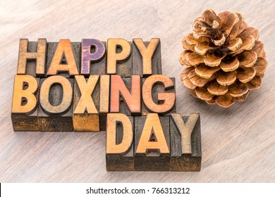 Happy Boxing Day word abstract in vintage letterpress wood type wityh pine cone