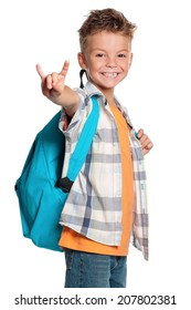 Happy boy with backpack showing rock and roll sign, isolated on white background
