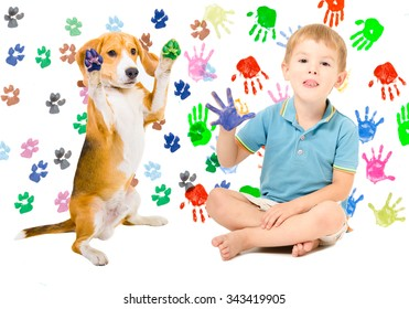 Happy boy with Beagle sitting  on the background of handprints