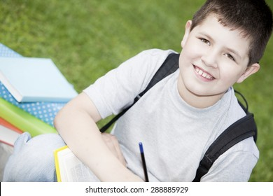 Happy boy with books, back to school