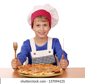 happy boy chef eat pizza