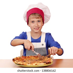 happy boy chef eating pizza
