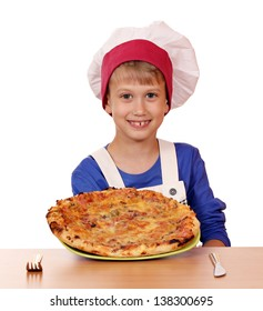 happy boy chef hold pizza on table