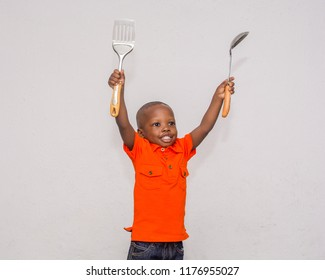Happy boy with cooking utensils