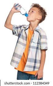 Happy boy drinks water from a bottle isolated on white background