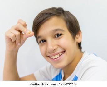 Happy boy with fingers up in studio