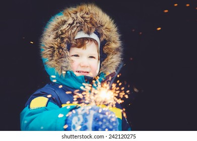 Happy boy with fireworks in his hands.
