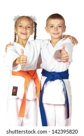 Happy boy and girl athletes karate champions