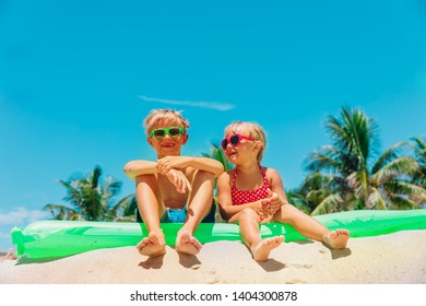 happy boy and girl have fun on beach