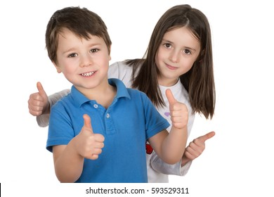 Happy boy and a girl smiling with thumbs up. Isolated on a white background.