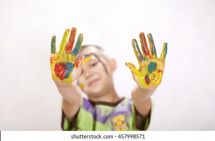 Happy boy hands in the paint