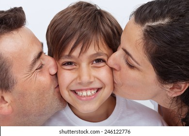 Happy boy having the attention of his parents kissing him - love concept