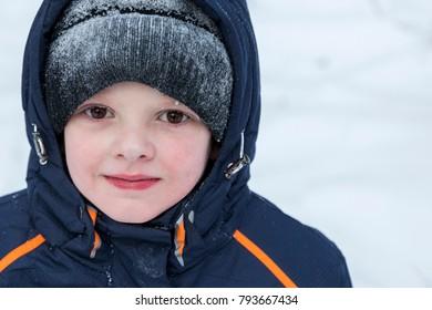 happy boy in a hoarfrost in the winter