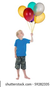 Happy boy holding a bunch of balloons, against a white background.